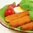 Fish sticks with egg salad on a platter. - Stock Photo
