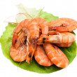 Fresh shrimp on lettuce leaf, isolated on a white background — Stock Photo