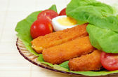Fish sticks with egg salad on a platter. — Stock Photo