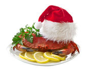 Crab in Santa Claus hat on a platter isolated on white background — Zdjęcie stockowe