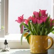 Bouquet of tulips on the windowsill — Stock Photo
