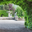 A fountain in the park of roses. Germany, Baden-Baden. - Stock Photo