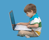 Boy with laptop isolated on a blue background — Stock Photo