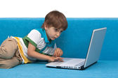Boy with laptop isolated on white background — Stock Photo