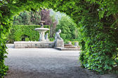 A fountain in the park of roses. Germany, Baden-Baden. — Stock Photo