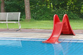 Children's pool with slide — Stock Photo