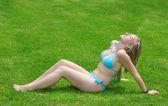 Girl in grass — Stock Photo