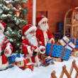 The group of Santa Clauses with gifts — Stock Photo