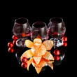 Glasses of wine, tangerine and chocolate on a black background — Stock Photo