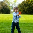 A child playing with a ball in the park — Stock Photo