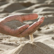 Sand flowing through your fingers — Stockfoto