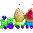 A toy train takes ripe pears. — Stock Photo