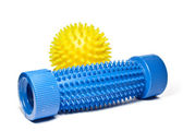 Yellow massage ball with a blue foot massager. — Stock Photo