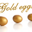 Golden egg on a white background — Stock Photo