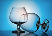 Beautiful wine glasses on a blue background — Stock Photo