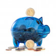 Stock Photo: Pig coin box with coins on white background