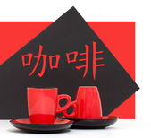 """Red coffee cups on a black background with a hieroglyph """"coffee"""" — Stockfoto"""