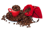 Coffee grains in a bag and in a red cup — Stockfoto