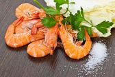 Prawns with a sprig of parsley and salad close up. — Stock Photo