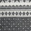 Texture of the Norwegian sweater hand-knitted. - Zdjęcie stockowe