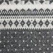 Texture of the Norwegian sweater hand-knitted. - Stock Photo