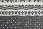 Texture of the Norwegian sweater hand-knitted. — Stock Photo
