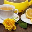 Tea with lemon and yellow rose. — Stock Photo