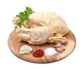 Raw chicken in the marinade on a white background — Stock Photo
