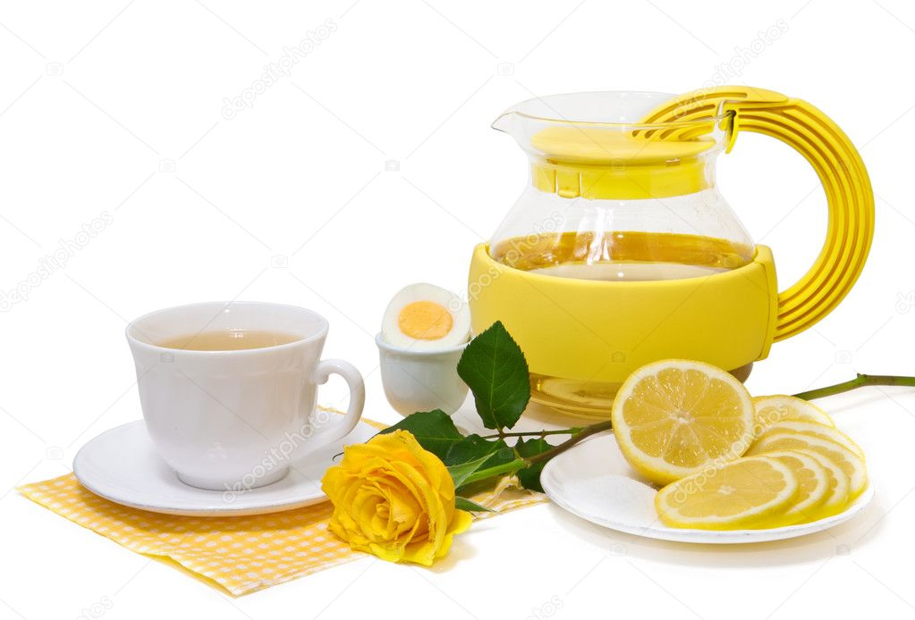 Tea with lemon and yellow roses on a white background — Stock Photo #9569857
