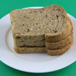 Sliced multigrain Bread on the white plate — Stock Photo #8162304