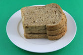 Sliced multigrain Bread on the white plate — Stock Photo