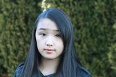 Portrait of pretty Asian girl — Stock Photo