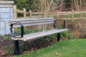 Abandoned bench in a park — Stock Photo