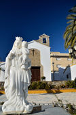 Statue in front of church — Stock Photo