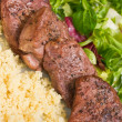 Tenderloin steaks in wine sauce with cadamon and kuskus groats — Stock Photo