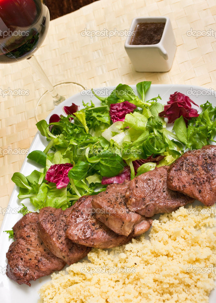 Tenderloin steaks in wine sauce with cadamon and kuskus groats — Stock Photo #7978760