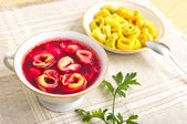 Traditional christmas borscht with dumplings — Stock Photo