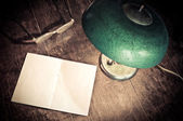 Old lamp and blank paper — Stock Photo