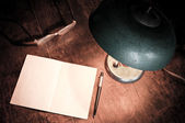 Old lamp and paper — Stock Photo
