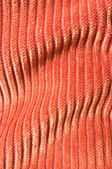Orange undulating corduroy texture — Stock Photo