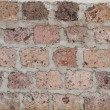Weathered stained old brick wall background — Stok fotoğraf