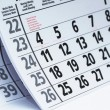 Stock Photo: Calendar fragment with half-opened sheets in different angles