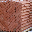Brick wall under construction - Stock Photo