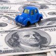 Royalty-Free Stock Photo: Toy car on money background