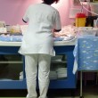 Nurse taking care of a newborn — 图库照片