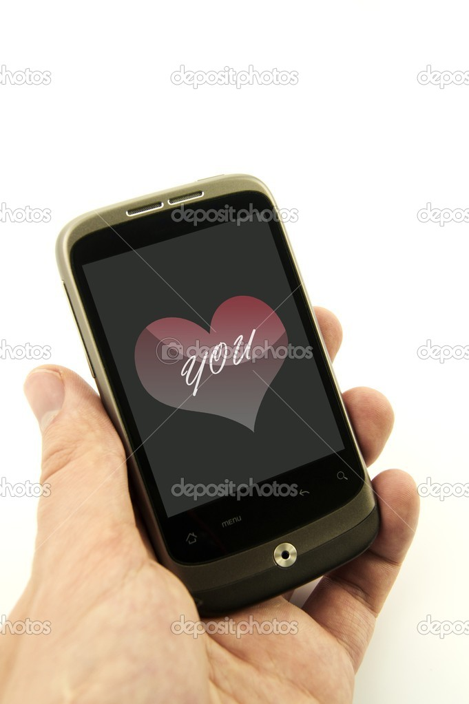 Cell phone with valentine card — Stock Photo #8349865