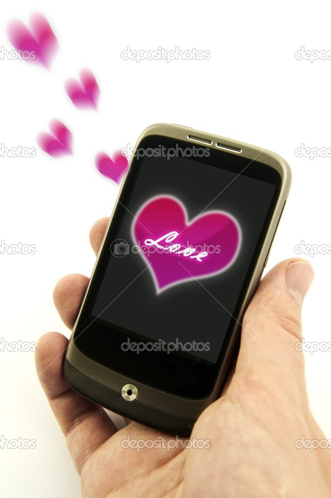 Hand holding phone with valentine love message. Pink hearts are flying from display — Stock Photo #8349889