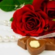Rose, pearls and chocolate — Stock Photo