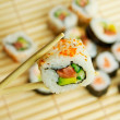 Hand holding sushi. Japanese traditional food — Stock Photo #8879616