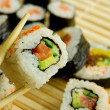 Traditional japanese sushi on bamboo napkin — Stock Photo #8879617